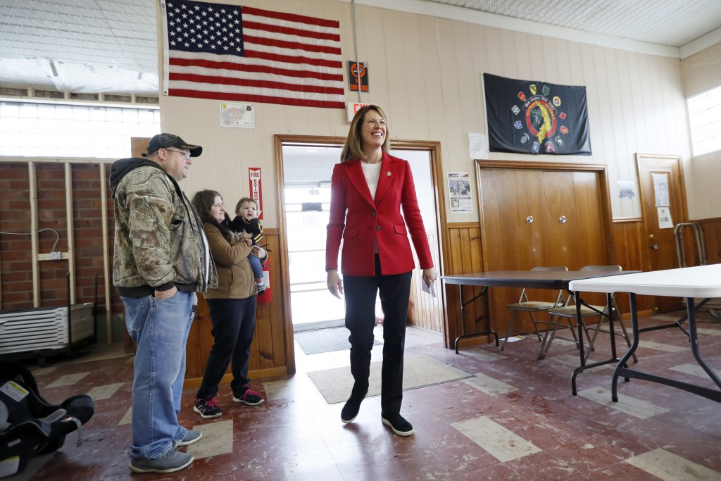 In this Nov. 11, 2019, photo, U.S. Rep. Cindy Axne, D-Iowa, arrives to speak to local residents at the American Legion Post 184 in Winterset, Iowa. Ax...