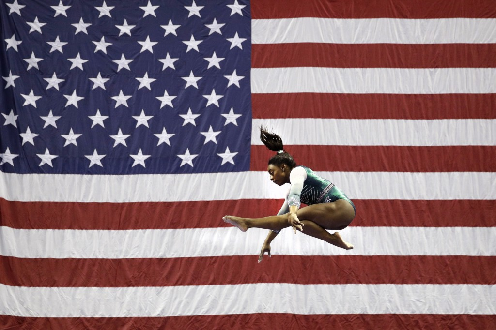 File-This Aug. 9, 2019, file photo shows Simone Biles competing on the beam during the senior women's competition at the U.S. Gymnastics Championships...