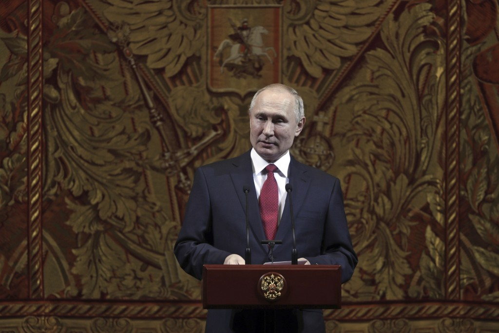 Russian President Vladimir Putin delivers his speech at a gala on the occasion of the New Year at the Bolshoi Theater in Moscow, Russia, Thursday, Dec...