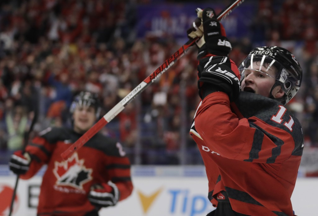 Canada's Alexis Lafreniere celebrates after scoring his sides fifth goal during the U20 Ice Hockey Worlds match between Canada and the United States i...