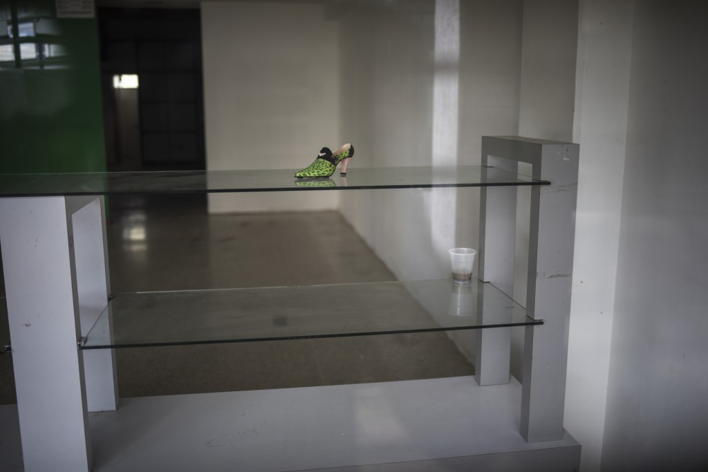 A lone shoe sits on a display table at a store that was unable to reopen after the mall where it is located was looted during nation-wide blackouts in...