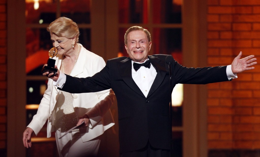 FILE - In this June 7, 2009, file photo, Jerry Herman accepts his Special Tony Award for Lifetime Achievement in the Theater from Angela Lansbury at t...