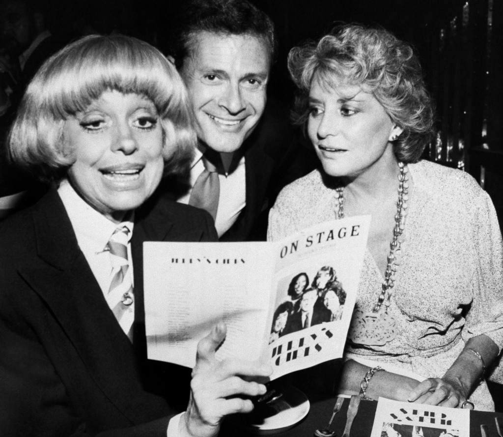 FILE - In this Sept. 1, 1981, file photo, Carole Channing, left, and television personality Barbara Walters look over the program with composer-lyrici...