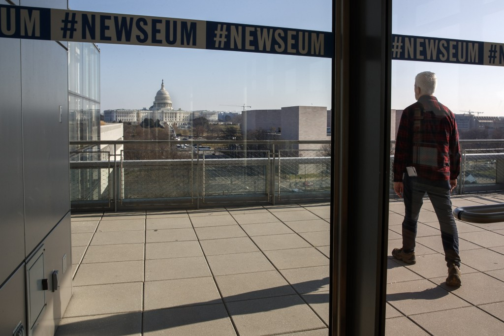 In this Friday, Dec. 20, 2019, photo, a man walks onto the terrace with the Capitol in the background at the Newseum in Washington. The Newseum will c...
