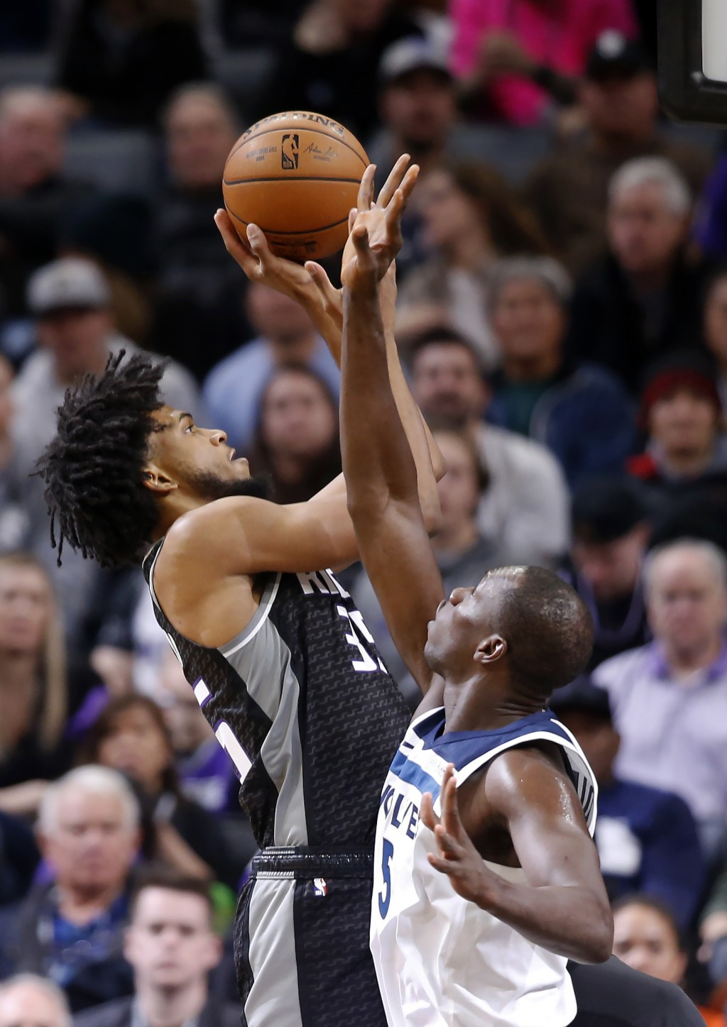 Sacramento Kings forward Marvin Bagley III, left, goes to the basket against Minnesota Timberwolves center Gorgui Dieng, right, during the first quart...