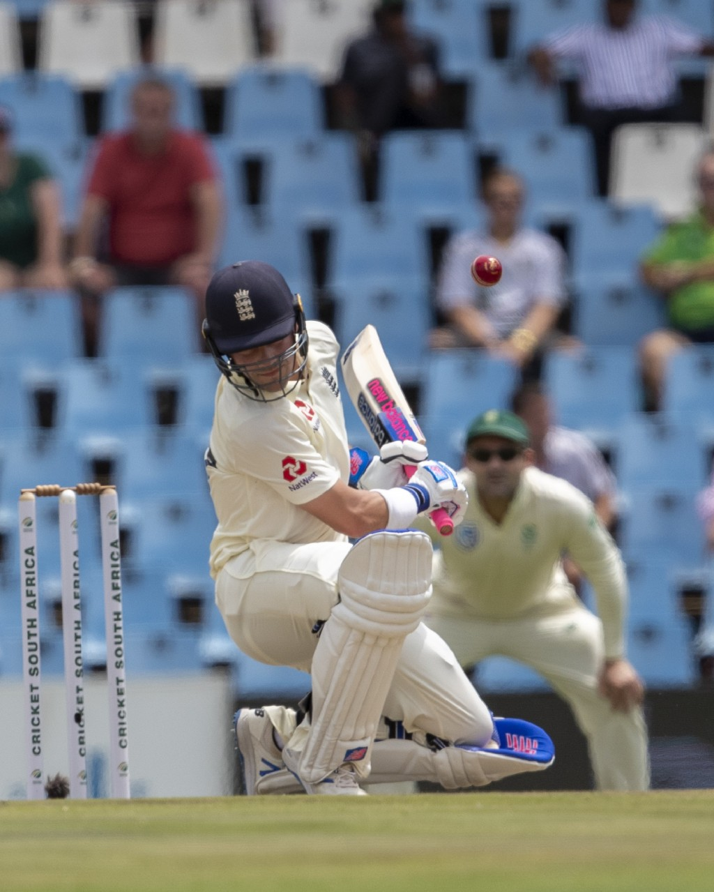 England's batsman Rory Burns avoids a bouncer from South Africa's bowler Kagiso Rabada on day two of the first cricket test match between South Africa...