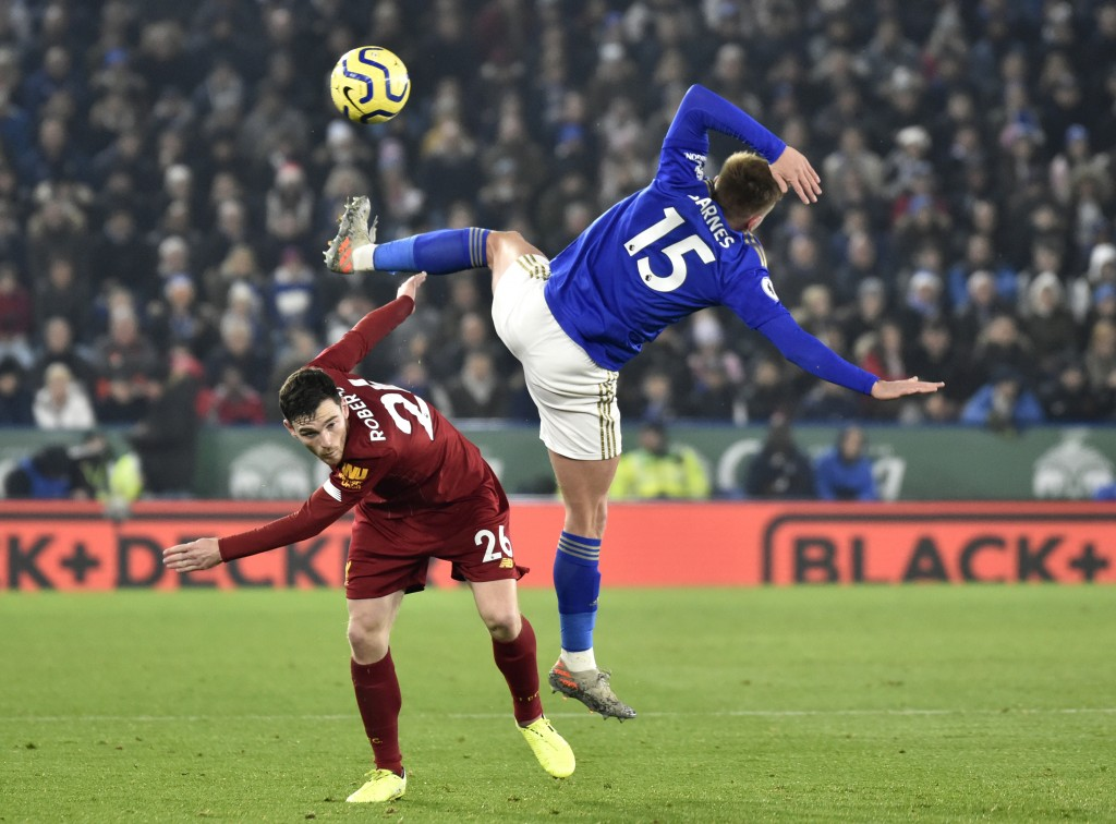 Liverpool's Andrew Robertson, left, and Leicester's Harvey Barnes challenge for the ball during the English Premier League soccer match between Leices...