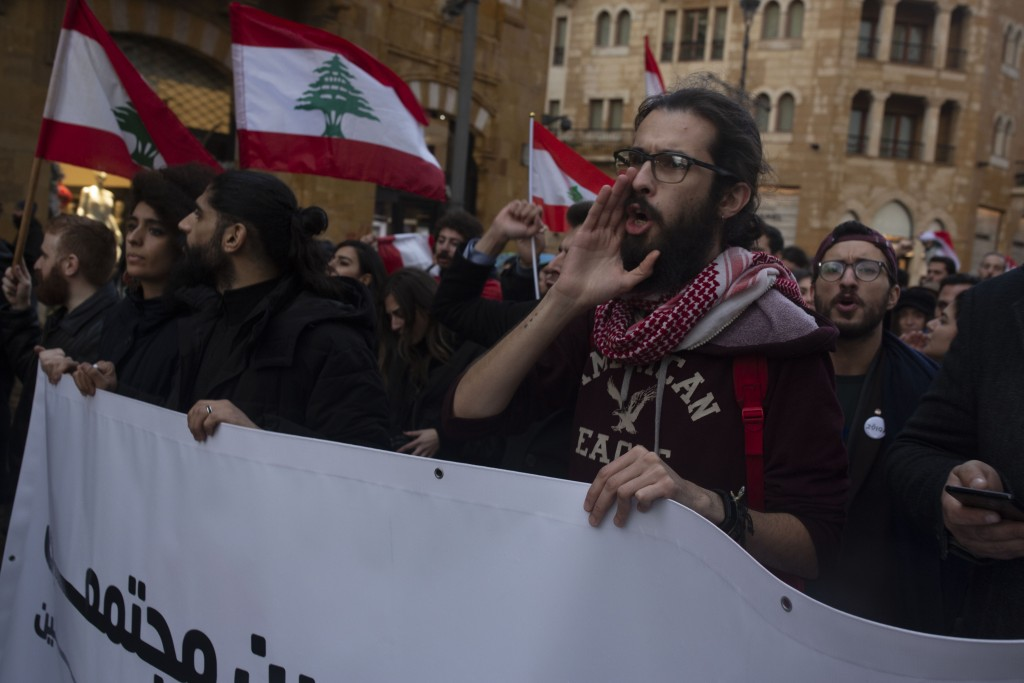 Lebanese expatriates chant anti-government slogans at a protest outside of the Parliament building Thursday, Dec. 26, 2019 in Beirut, Lebanon. (AP Pho...