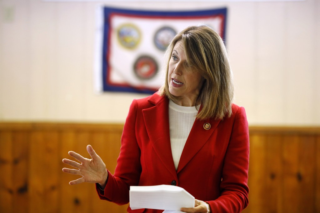 In this Nov. 11, 2019, photo, U.S. Rep. Cindy Axne, D-Iowa, speaks to local residents at the American Legion Post 184 in Winterset, Iowa. Axne defeate...