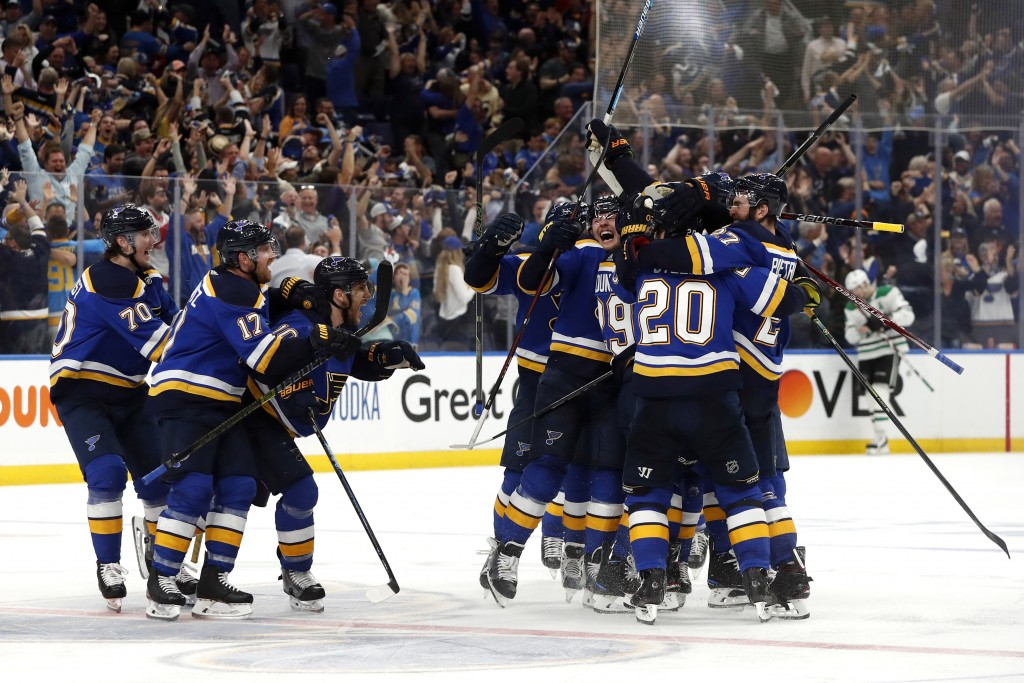 FILE - In this May 7, 2019, file photo, St. Louis Blues celebrate after defeating the Dallas Stars in double overtime in Game 7 of an NHL second-round...