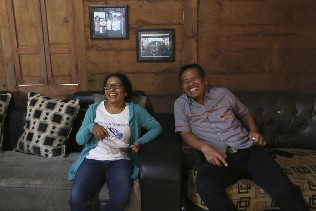 Ni Luh Erniati, left, laughs with Ali Fauzi during her visit to Fauzi's house in Tenggulun, East Java, Indonesia, on Saturday, April 27, 2019. Erniati...
