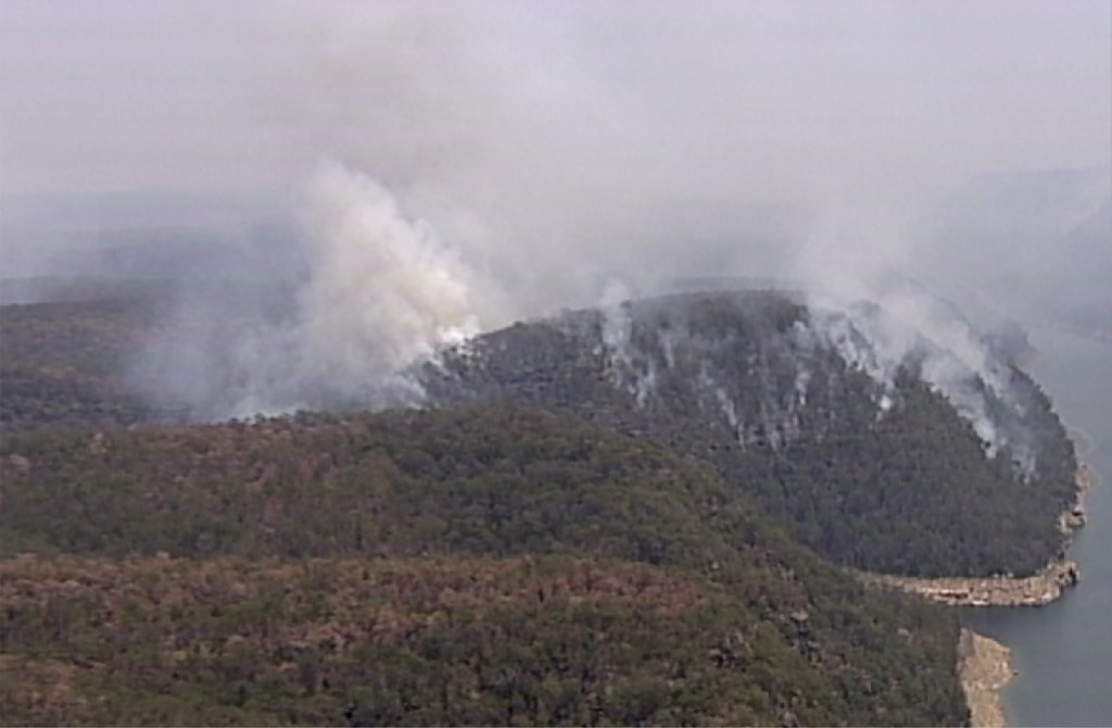 In this image made from video, smoke rises from wildfires Friday, Dec. 27, 2019, in the Blue Mountains, New South Whales, Australia. Firefighters batt...
