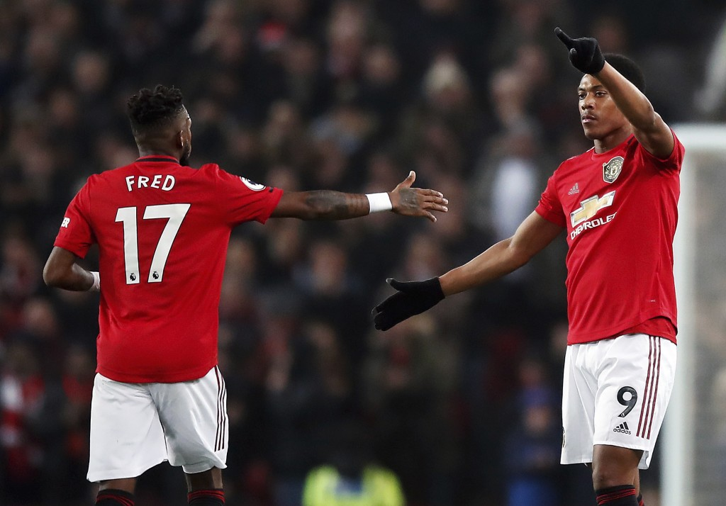 Manchester United's Anthony Martial, right, celebrates scoring his side's first goal of the game with teammate Fred during their English Premier Leagu...
