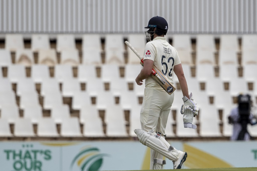 England's batsman Dom Sibley leaves the field after being dismissed by South Africa's bowler Kagiso Rabada for 4 runs on day two of the first cricket ...