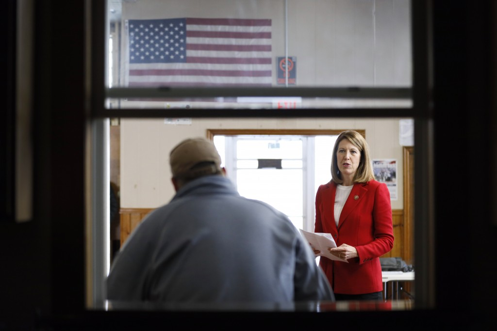 FILE - In this Nov. 11, 2019, file photo, Rep. Cindy Axne, D-Iowa, speaks to local residents at the American Legion Post 184 in Winterset, Iowa. Few s...