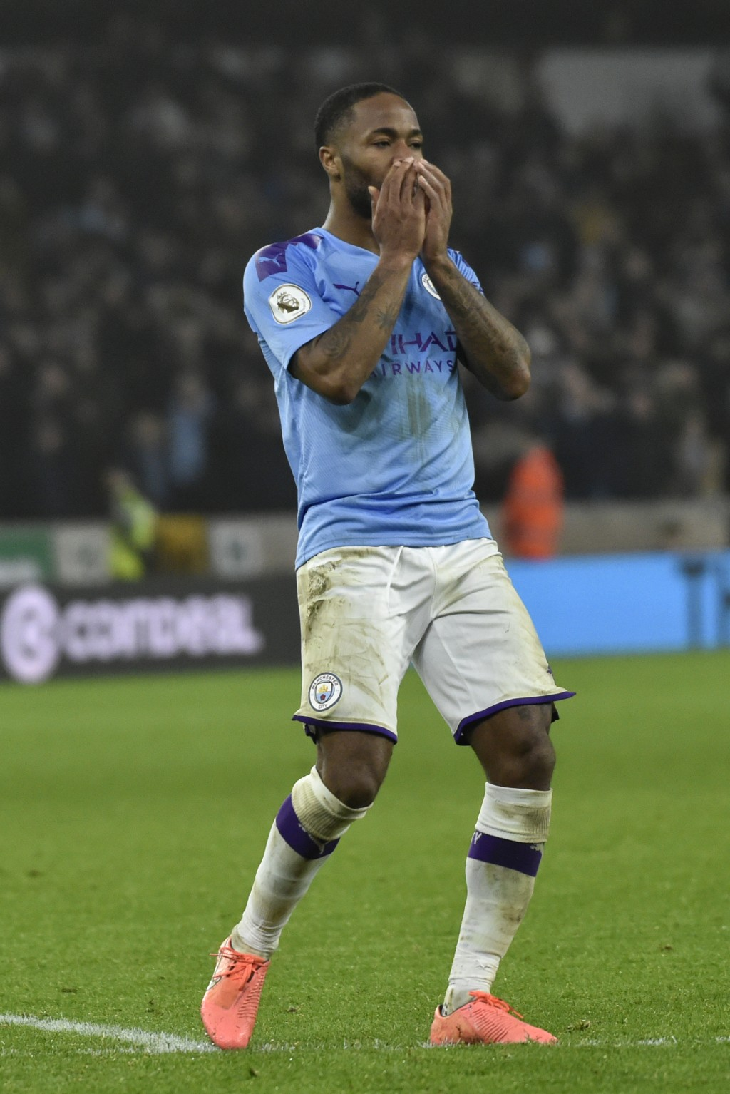 Manchester City's Raheem Sterling touches his face after Wolverhampton Wanderers' Matt Doherty at the end of an English Premier League soccer match be...