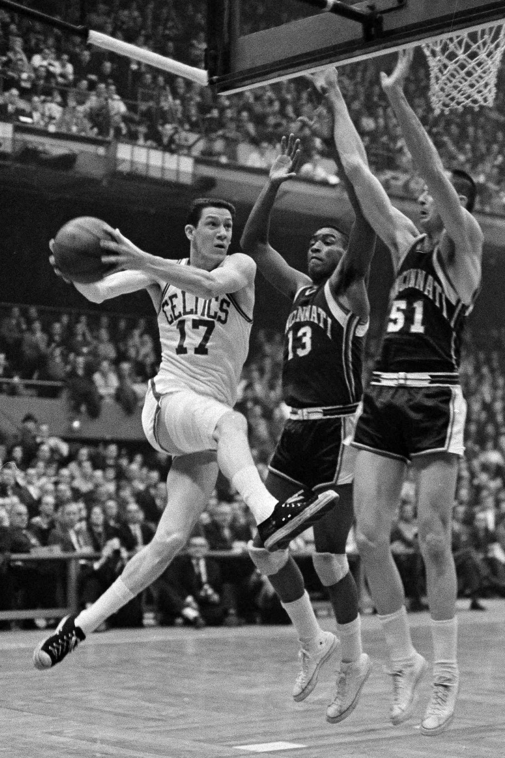 FILE - This March 31, 1963, file photo showing Boston Celtics' John Havlicek going to the basket against Cincinnati Royals Bob Booser (13) and Hub Ree...