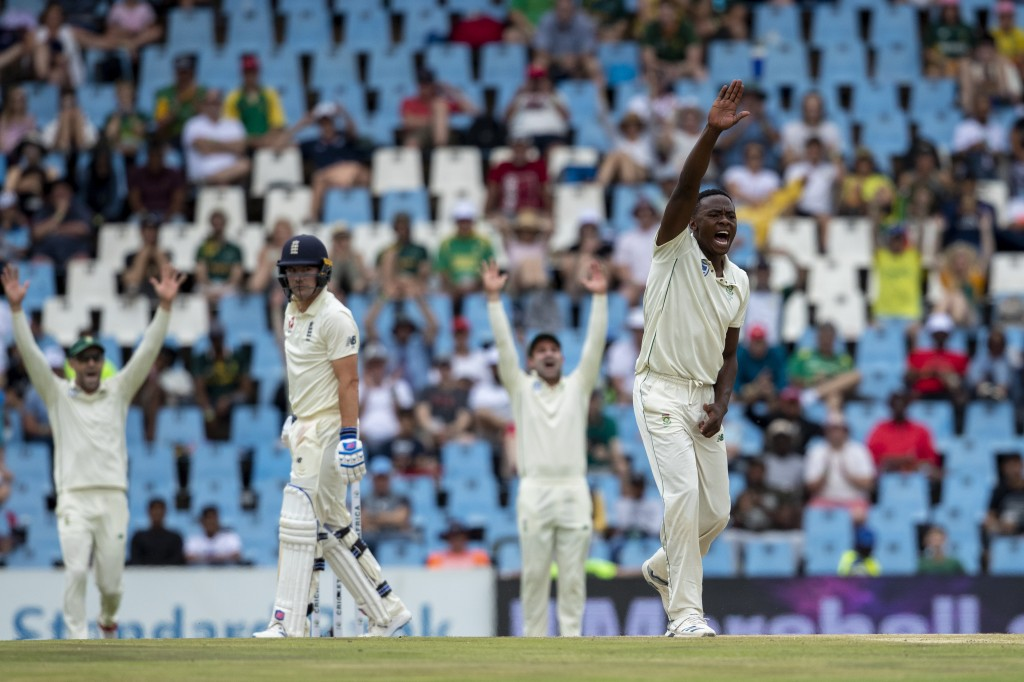 South Africa's bowler Kagiso Rabada, right, and teammates appeals unsuccessfully for the wicket of England's batsman Rory Burns, second from left, on ...