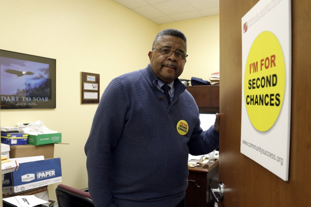In this photo taken Wednesday, Dec. 18, 2019 Dennis Gaddy, the co-founder of the Raleigh-based Community Success Initiative, is shown at the door to h...