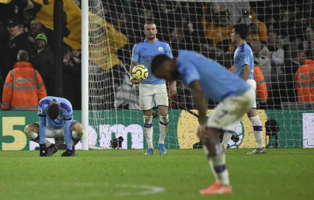 Manchester City' players react after Wolverhampton Wanderers' Matt Doherty scored his side's third goal, during the English Premier League soccer matc...