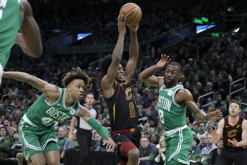 Cleveland Cavaliers guard Collin Sexton (2) drives between Boston Celtics guards Romeo Langford (45) and Kemba Walker (8) in the first half of an NBA ...