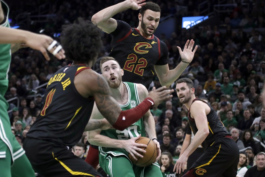 Boston Celtics forward Gordon Hayward looks for room to maneuver with the ball against Cleveland Cavaliers guard Kevin Porter Jr. (4), forward Larry N...