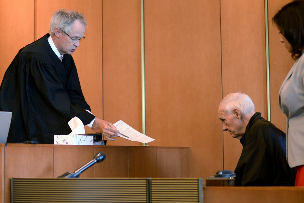 FILE - In this Monday, Aug. 10, 2015 file photo, Judge Timothy Feeley, left, addresses former the Rev. Richard J. McCormick, 74, in Salem Superior Cou...