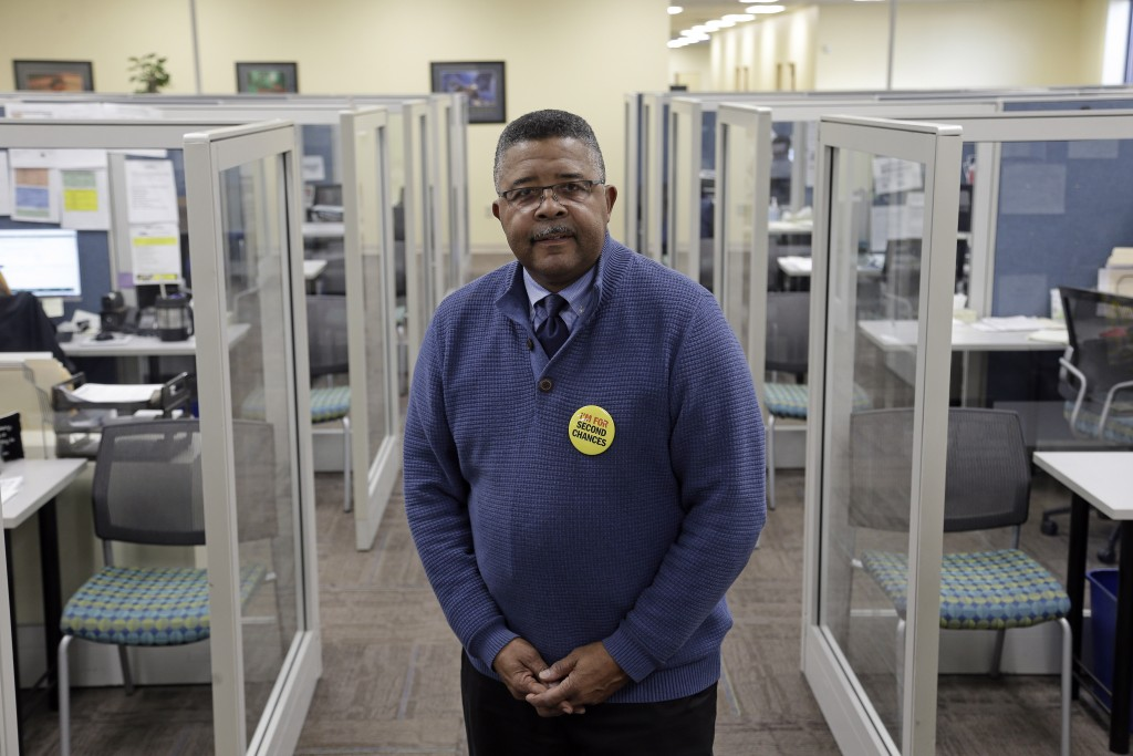In this photo taken Wednesday, Dec. 18, 2019 Dennis Gaddy, the co-founder of Community Success Initiative is shown at the Raleigh, N.C. office. Gaddy,...
