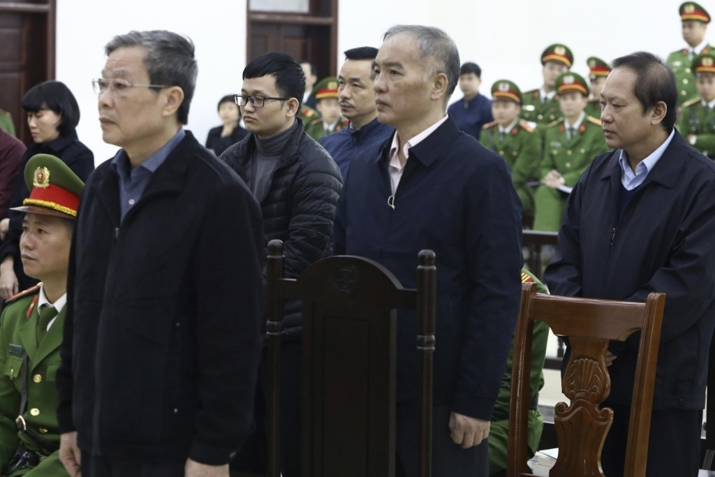 Vietnamese former Minister of information and communication Nguyen Bac Son, left, valuer Hoang Duy Quang, second left, former Mobifone Chairman Le Nam...