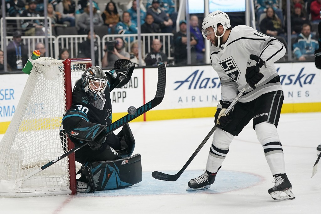 San Jose Sharks goaltender Aaron Dell (30) blocks a shot by Los Angeles Kings center Michael Amadio (10) during the second period of an NHL hockey gam...