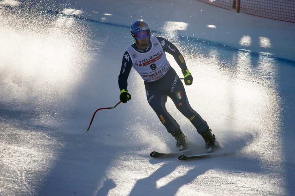 Italy's Dominik Paris arrives at the finish area of an alpine ski, men's World Cup downhill, in Bormio, Italy, Saturday, Dec. 28, 2019. (AP Photo/Ales...