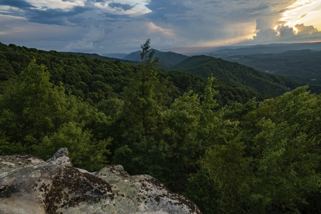 This July 2019 photo provided by The Nature Conservancy shows a sunset overlooking the rolling Appalachian mountains at Flag Rock Recreation Area in N...
