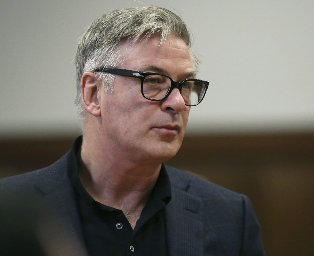 FILE - In this Jan. 23, 2019, file photo, actor Alec Baldwin stands in a New York City court, for a hearing on charges that he slugged a man during a ...
