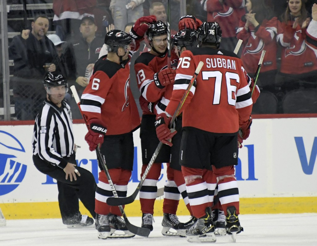 New Jersey Devils center Nico Hischier (13) celebrates his goal with teammates during the first period of an NHL hockey game against the Toronto Maple...