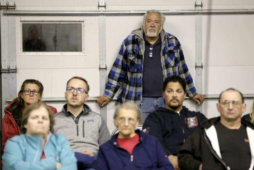 In this Oct. 24, 2019 photo, Bill Whitney, rear, listens at a town hall meeting at the fire hall in Winslow, Neb., where relocating the village was di...