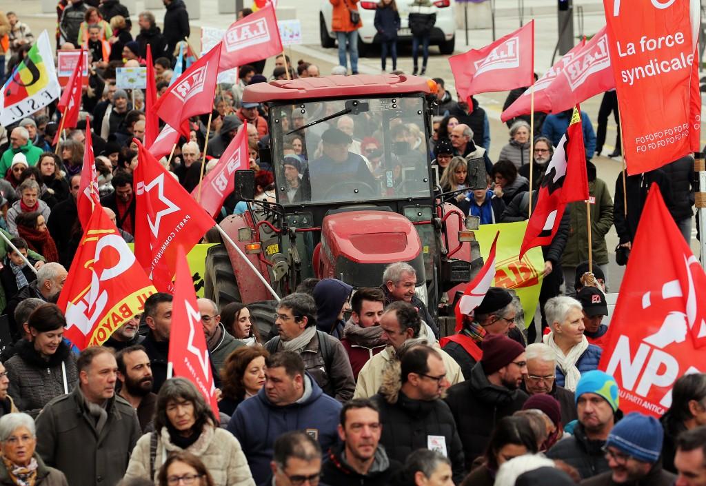 Trade union demonstrators gather in Bayonne, southwestern France, Saturday, Dec. 28, 2019. France's punishing transportation troubles may ease up slig...