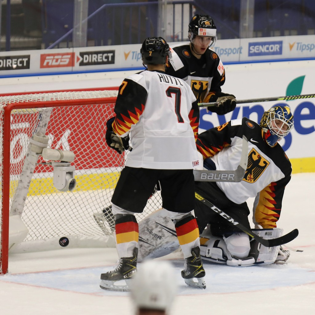 Germany goalkeeper Tobias Ancicka, right, fails to make a save as teammate Leon Huettl, left, looks on during the 2020 IIHF World Junior Ice Hockey Ch...