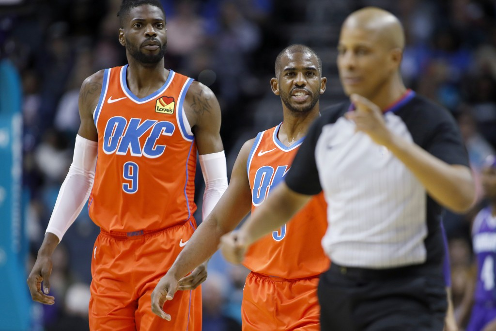 Oklahoma City Thunder's Chris Paul (3) gets help from teammate Nerlens Noel (9) as he argues a call that went against him and to the Charlotte Hornets...