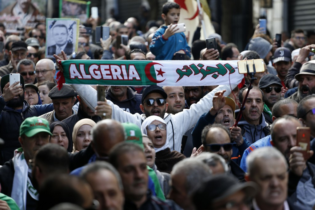 Protesters take to the streets in the capital Algiers to reject the presidential elections and protest against the government, in Algeria, Friday, Dec...
