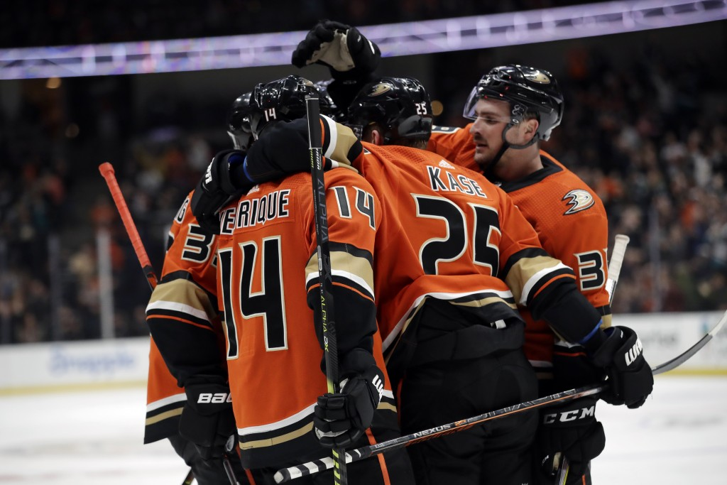 Anaheim Ducks' Adam Henrique (14) celebrates his goal with teammates during the second period of an NHL hockey game against the Vegas Golden Knights o...