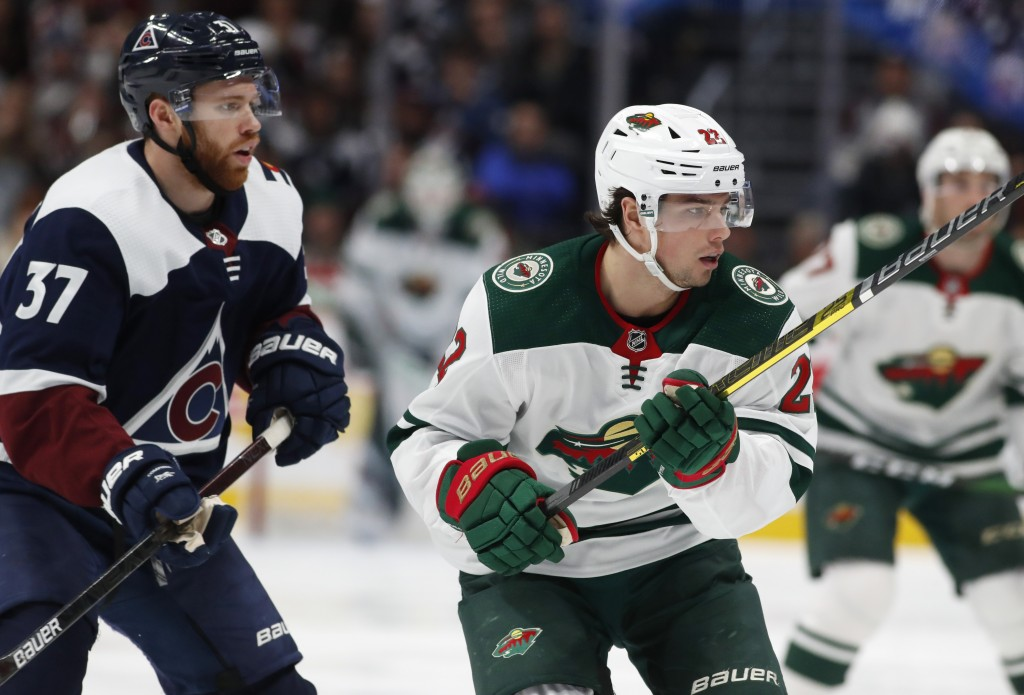 Minnesota Wild left wing Kevin Fiala, right, looks for a pass from a teammate as he drives past Colorado Avalanche left wing J.T. Compher, left, in th...