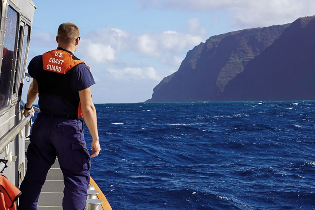 CORRECTS THE NAME OF THE PHOTOGRAPHER - In this photo released by the U.S. Coast Guard, Coast Guard Cutter William Hart moves toward the Na Pali Coast...