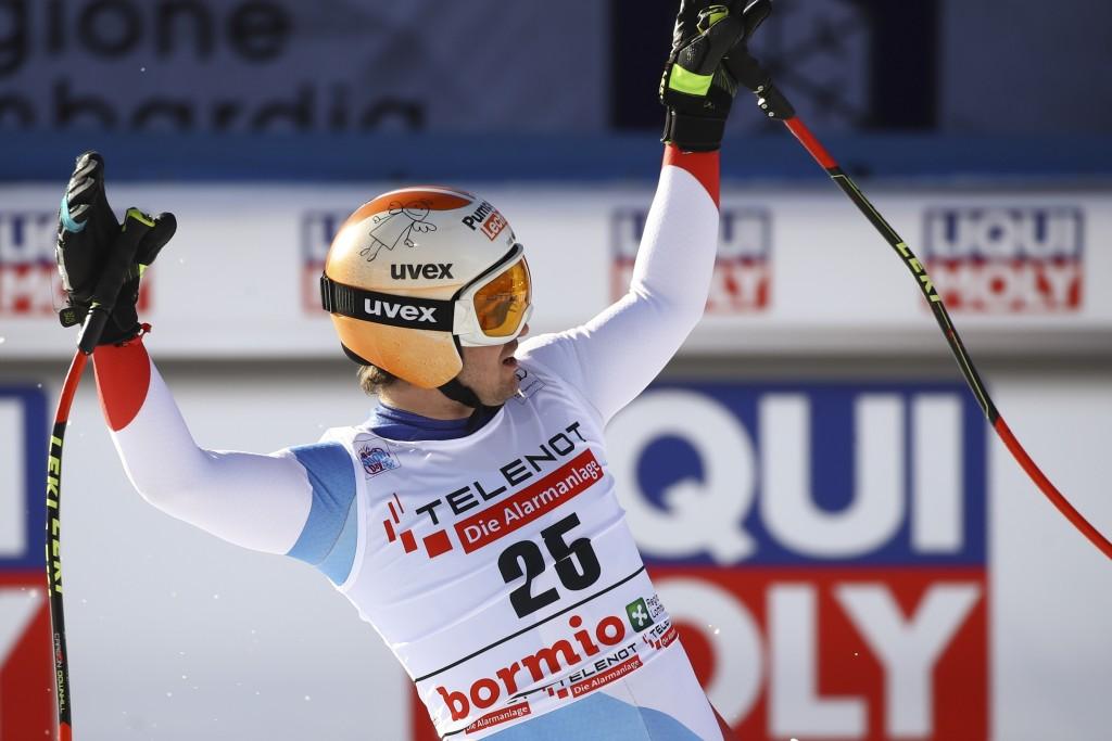Switzerland's Urs Kryenbuehl celebrates at the finish area of an alpine ski, men's World Cup downhill, in Bormio, Italy, Saturday, Dec. 28, 2019. (AP ...