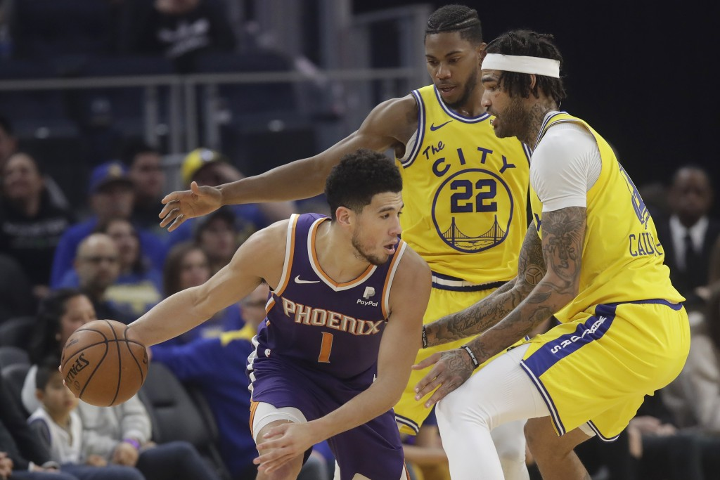 Phoenix Suns guard Devin Booker (1) is is defended by Golden State Warriors forward Glenn Robinson III (22) and center Willie Cauley-Stein during the ...