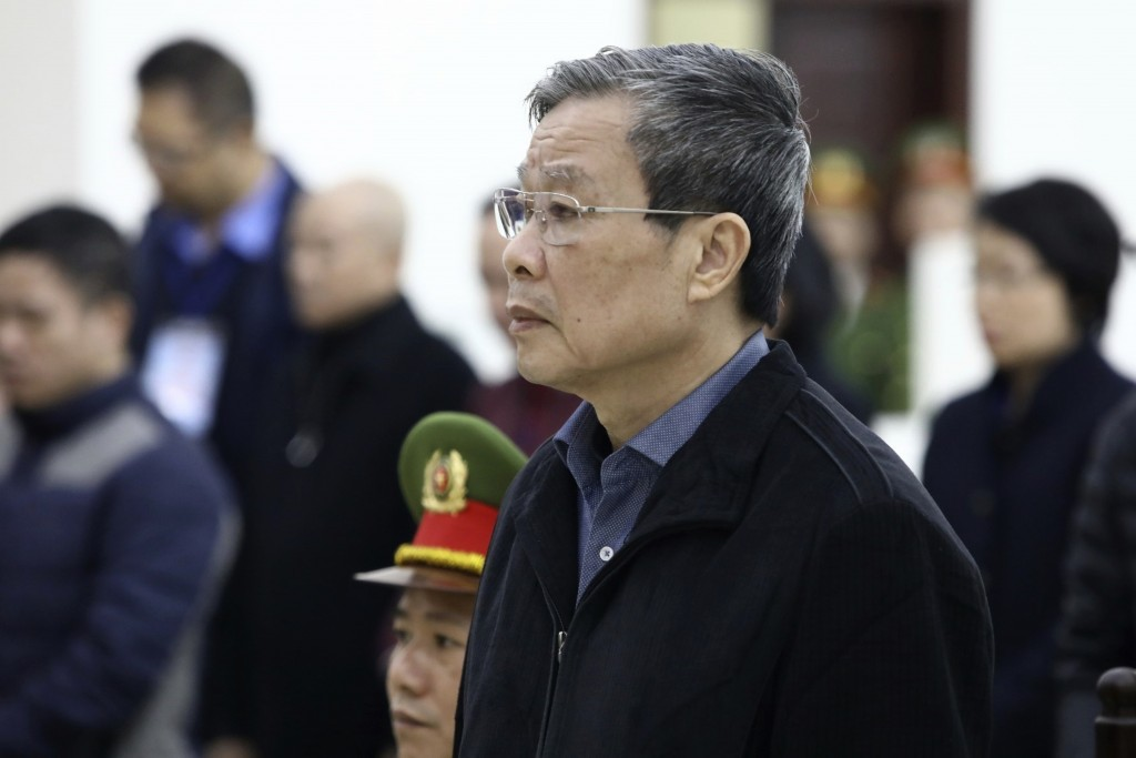 Vietnamese former Minister of information and communication Nguyen Bac Son stands as judge reads the verdicts at his trial in Hanoi, Vietnam Saturday,...