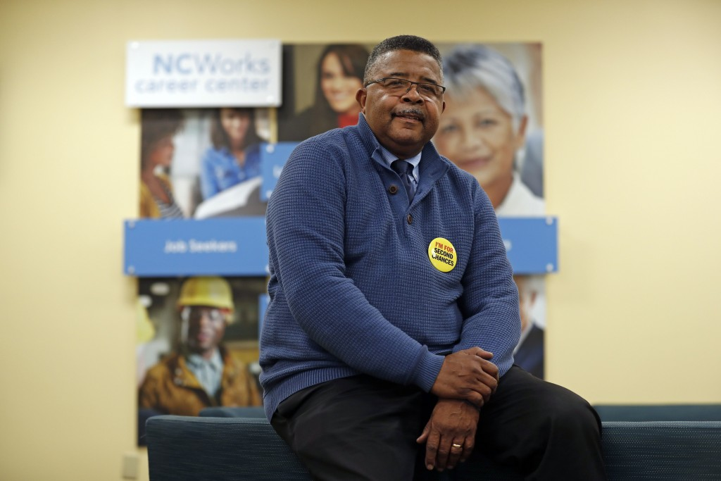 In this photo taken Wednesday, Dec. 18, 2019 Dennis Gaddy, the co-founder of Community Success Initiative is seen in the Raleigh, N.C. office. Gaddy, ...