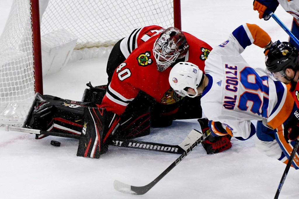 Chicago Blackhawks goaltender Robin Lehner (40) defends against New York Islanders left wing Michael Dal Colle (28) during the second period of an NHL...