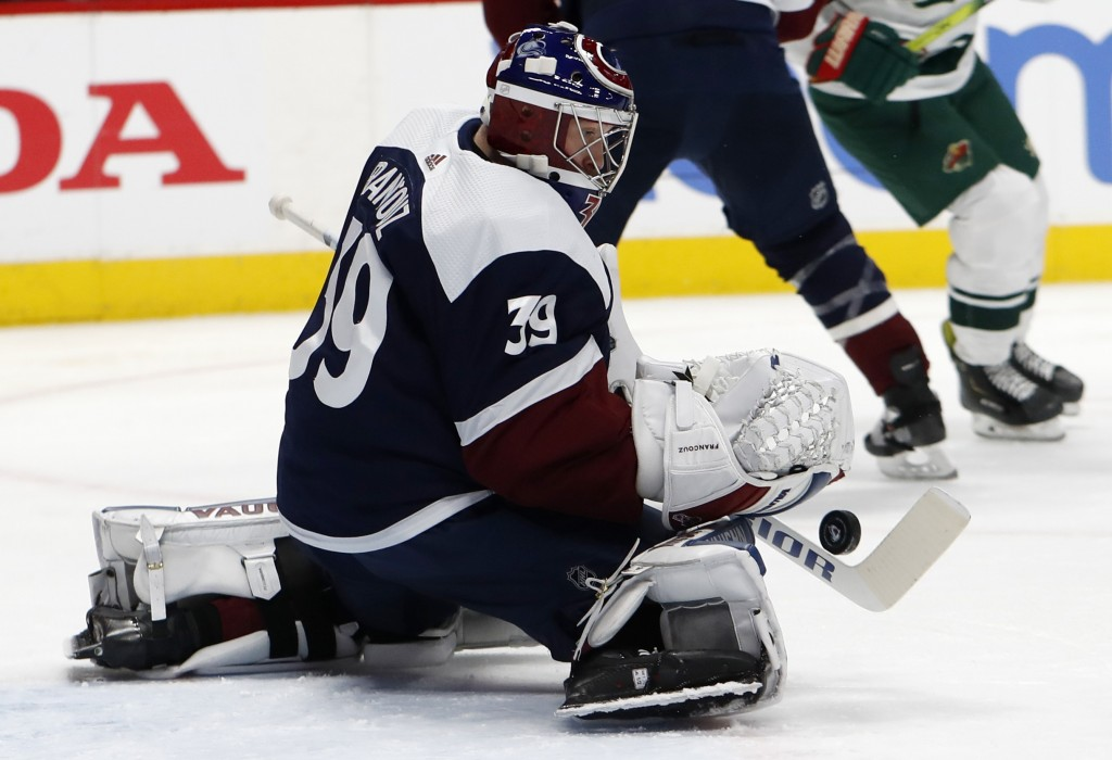 Colorado Avalanche goaltender Pavel Francouz makes a stick-save of a shot in the second period of an NHL hockey game against the Minnesota Wild, Frida...