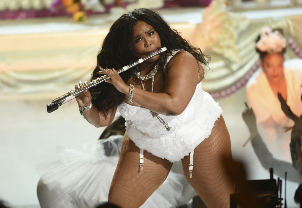 FILE - This June 23, 2019 file photo shows Lizzo playing the flute at the BET Awards in Los Angeles. Billie Eilish and Lizzo, are both nominated for t...