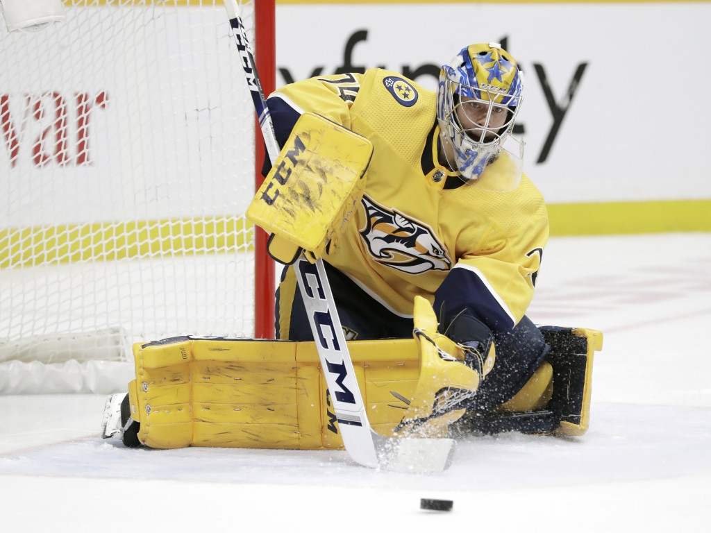 Nashville Predators goaltender Juuse Saros, of Finland, stops a shot by the Pittsburgh Penguins during the third period of an NHL hockey game Friday, ...